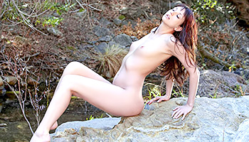 Watch how an incredible brunette got absolutely naked in the middle of nowhere and is about to show that perfect body of hers on camera.