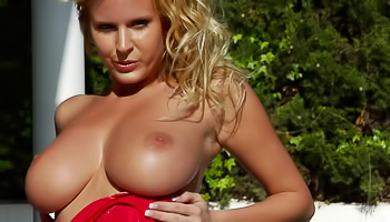 Luxurious blonde wearing red skirt is pleasing herself outdoors. She is enjoying passionate solo sex with great pleasure and excitement.