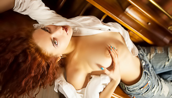Awesome ginger mademoiselle is enjoying passionate solo with great pleasure. She is massaging her sensational clit and touching wonderful big boobs.