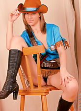 Tricia Nubiles : Tricia Nubiles takes her slutty cowgirl outfit off and shows us her fantastic ass.